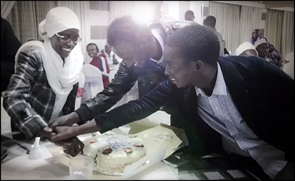 From left to right, Janet, Martin and Abdinoor celebrate their release with a cake.