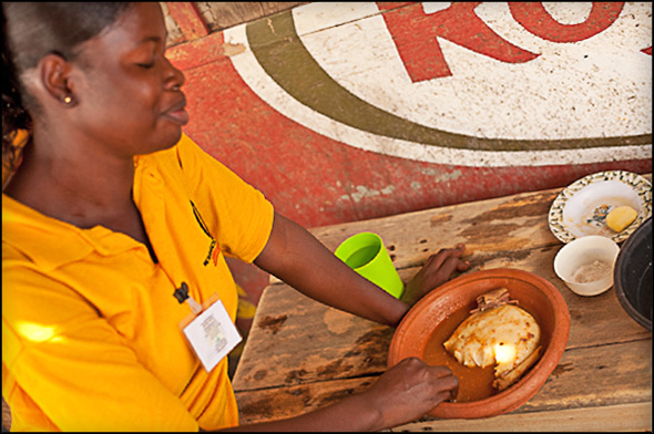 A customer enjoys a meal at  one of Comfort Kusiwaa's two  food vending locations.